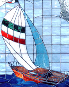 Closeup of large custom stained and leaded glass sailboat window