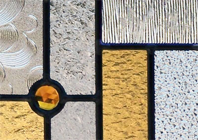 Closeup of stained and leaded glass abstract window