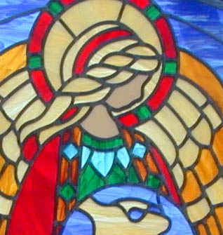 Custom stained and leaded glass angel has the whole world in her hands