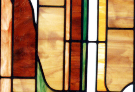 Closeup of custom stained and leaded glass abstract leaded glass window