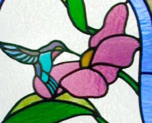 Closeup of custom hummingbird, flowers stained glass window