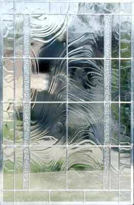 large custom leaded glass window of clear textured glasses