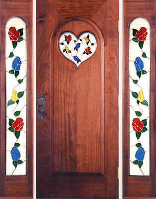 Entry with rosebud stained and leaded glass windows
