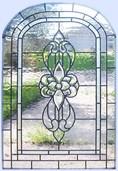 Custom leaded glass arched beveled window