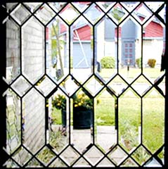 Clear all beveled custom leaded glass window