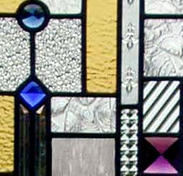 Closeup of Frank Lloyd Wright inspired custom stained and leaded glass window