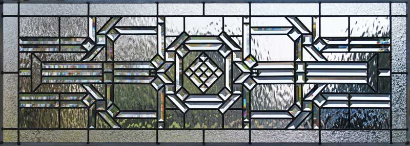 Custom leaded glass abstract pencil bevels transom window