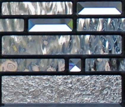 Closeup of custom leaded glass pencil bevel transom window