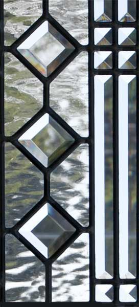 Closeup of custom abstract leaded glass pencil bevel window