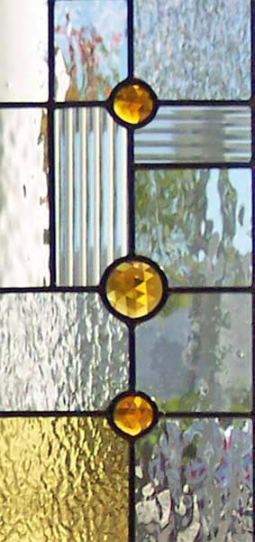 Closeup of custom abstract FLW leaded glass door window