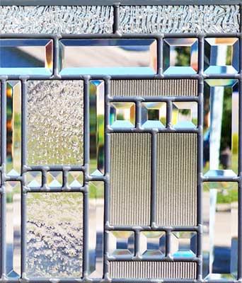 Closeup of leaded glass beveled abstract window of clear textured glass
