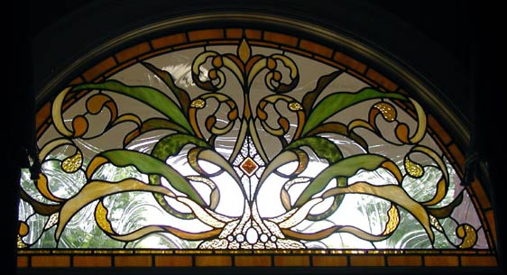 Hogan arched stained and leaded glass window