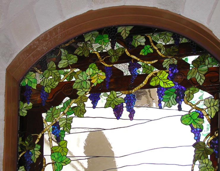 Closeup of custom stained glass Victorian style grapes window