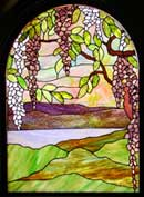 Custom wisteria arched stained glass window by Jack McCoy