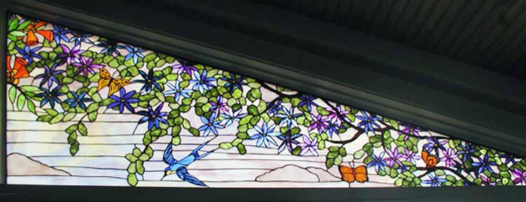 Custom trumpet vine, birds and butterflies stained glass window